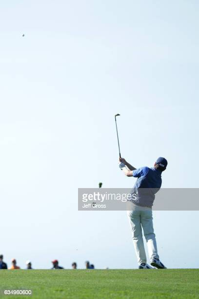 Derek Fathauer hits his approach shot on the sixth hole during the Final Round of the ATT Pebble Beach ProAm at Pebble Beach Golf Links on February...