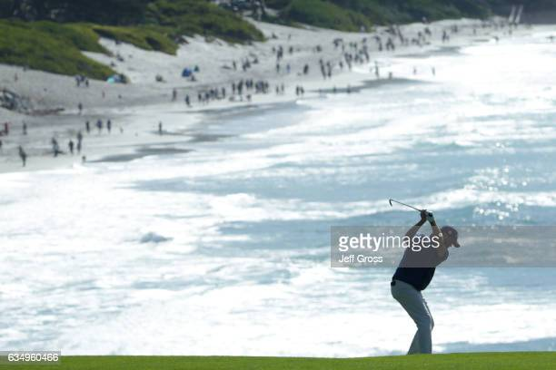 Derek Fathauer hits his second shot on the ninth hole during the Final Round of the ATT Pebble Beach ProAm at Pebble Beach Golf Links on February 12...