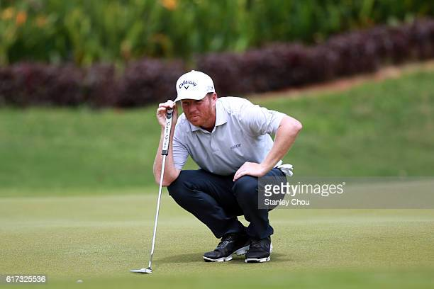 Derek Fathauer of the United States lies up for a putt on the17th hole during day four of the 2016 CIMB Classic at TPC Kuala Lumpur on October 23...