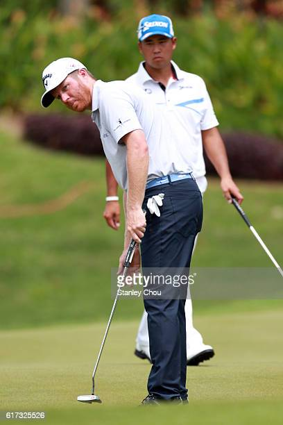 Derek Fathauer of the United States putts on the17th hole during day four of the 2016 CIMB Classic at TPC Kuala Lumpur on October 23 2016 in Kuala...