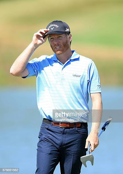 Derek Fathauer of the United States reacts to a par putt on the 18th hole during the third round of the RBC Canadian Open at Glen Abbey Golf Club on...