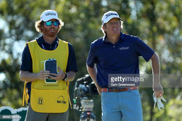Derek Fathauer talks with his caddie on the 13th hole during the First Round of the Sanderson Farms Championship at the Country Club of Jackson on...