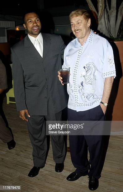 Derek Fisher and Dr Jerry Buss pose for photographers at the Los Angeles Lakers victory celebration at Ian Schrager's Ultra Chic Mondrian Hotel
