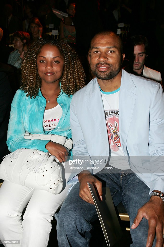 Derek Fisher and his girlfriend attend the Elie Saab 'Haute Couture' 2005-2006 Fall/Winter fashion collection in Paris.