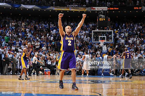 Derek Fisher and Kobe Bryant of the Los Angeles Lakers celebrate in the final seconds of overime against the Orlando Magic in Game Four of the 2009...