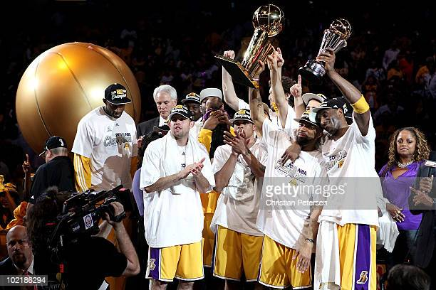 Derek Fisher and Kobe Bryant of the Los Angeles Lakers hold up the Larry O'Brien trophy and the MVP trophy after the Lakers defeated the Boston...