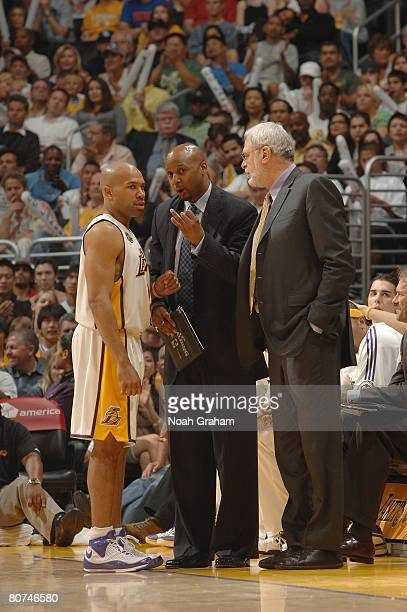 Derek Fisher assistant coach Brian Shaw and head coach Phil Jackson of the Los Angeles Lakers talk during the NBA game against the Golden State...