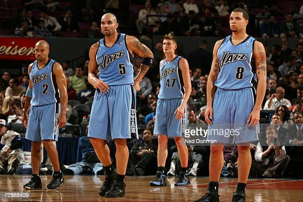 Derek Fisher Carlos Boozer Andrei Kirilenko and Deron Williams of the Utah Jazz stand together on the court during the NBA game against the New York...