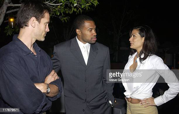 Derek Fisher chats with Constance Marie and her fiance at the Los Angeles Lakers victory celebration at Ian Schrager's Ultra Chic Mondrian Hotel