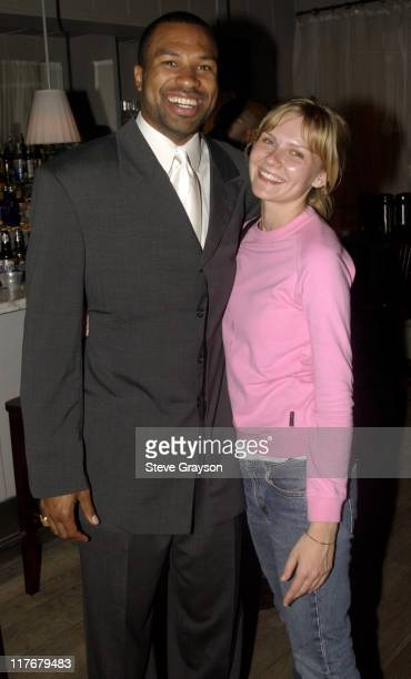 Derek Fisher Kirsten Dunst pose for photographers at the Los Angeles Lakers victory celebration at Ian Schrager's Ultra Chic Mondrian Hotel