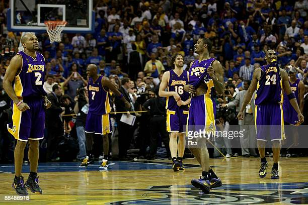 Derek Fisher Lamar Odom Pau Gasol Trevor Ariza and Kobe Bryant of the Los Angeles Lakers begin celebrating after defeating the Orlando Magic 9986 in...