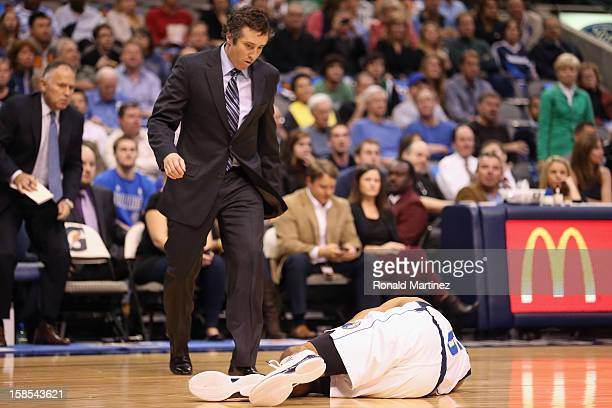Derek Fisher of the Dallas Mavericks falls on the court after an injury during play against the Philadelphia 76ers at American Airlines Center on...