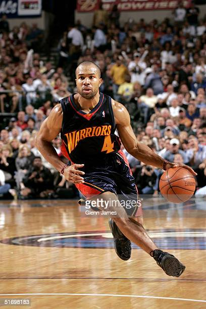 Derek Fisher of the Golden State Warriors dribbles up the court against the Dallas Mavericks on November 8 2004 at the American Airlines Center in...