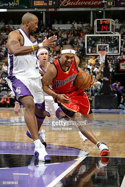 Derek Fisher of the Golden State Warriors drives to the basket around Brian Skinner of the Sacramento Kings on March 20 2005 at Arco Arena in...