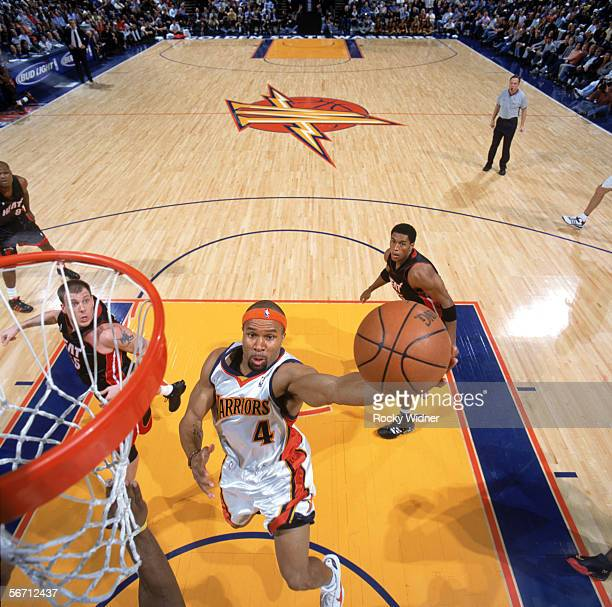 Derek Fisher of the Golden State Warriors drives to the basket for a layup during a game against the Miami Heat at The Arena in Oakland on January 11...