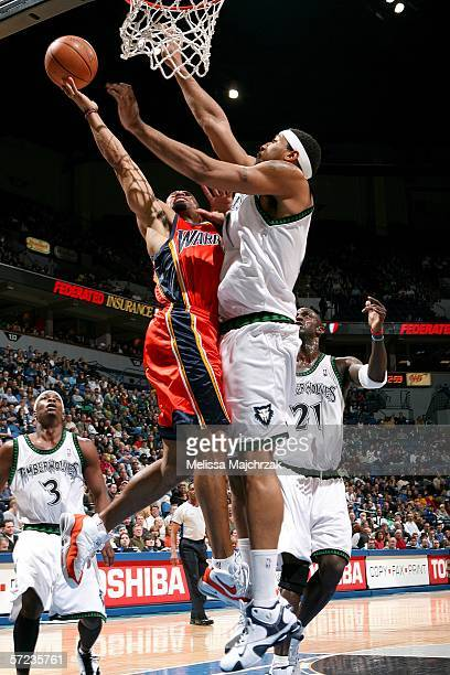 Derek Fisher of the Golden State Warriors goes up to the basket against Eddie Griffin of the Minnesota Timberwolves on April 2 2006 at the Target...