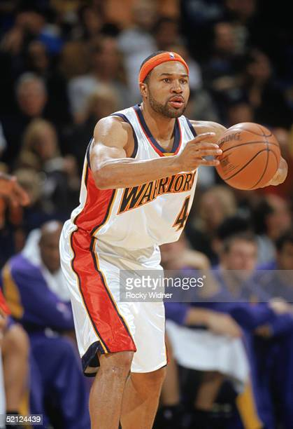 Derek Fisher of the Golden State Warriors passes during a game against the Los Angeles Lakers at the Arena in Oakland on January 15 2005 in Oakland...
