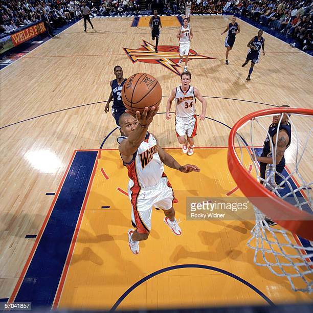 Derek Fisher of the Golden State Warriors reaches for the basket against the Memphis Grizzlies at The Arena in Oakland on February 13 2006 in Oakland...