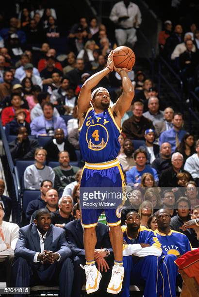 Derek Fisher of the Golden State Warriors shoots a jump shot during a game against the Philadelphia 76ers at The Arena in Oakland on January 3 2005...