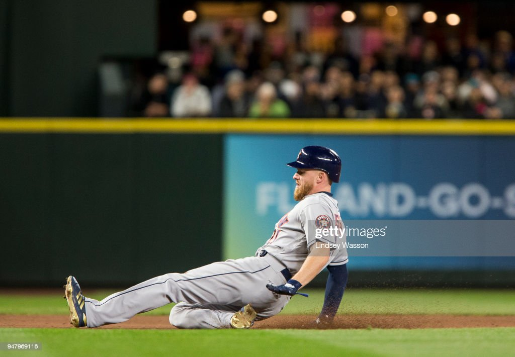 Derek Fisher #21 of the Houston Astros safely reaches third base on a wild pitch by Wade LeBlanc of the Seattle Mariners in the eighth inning at Safeco Field on April 17, 2018 in Seattle, Washington.