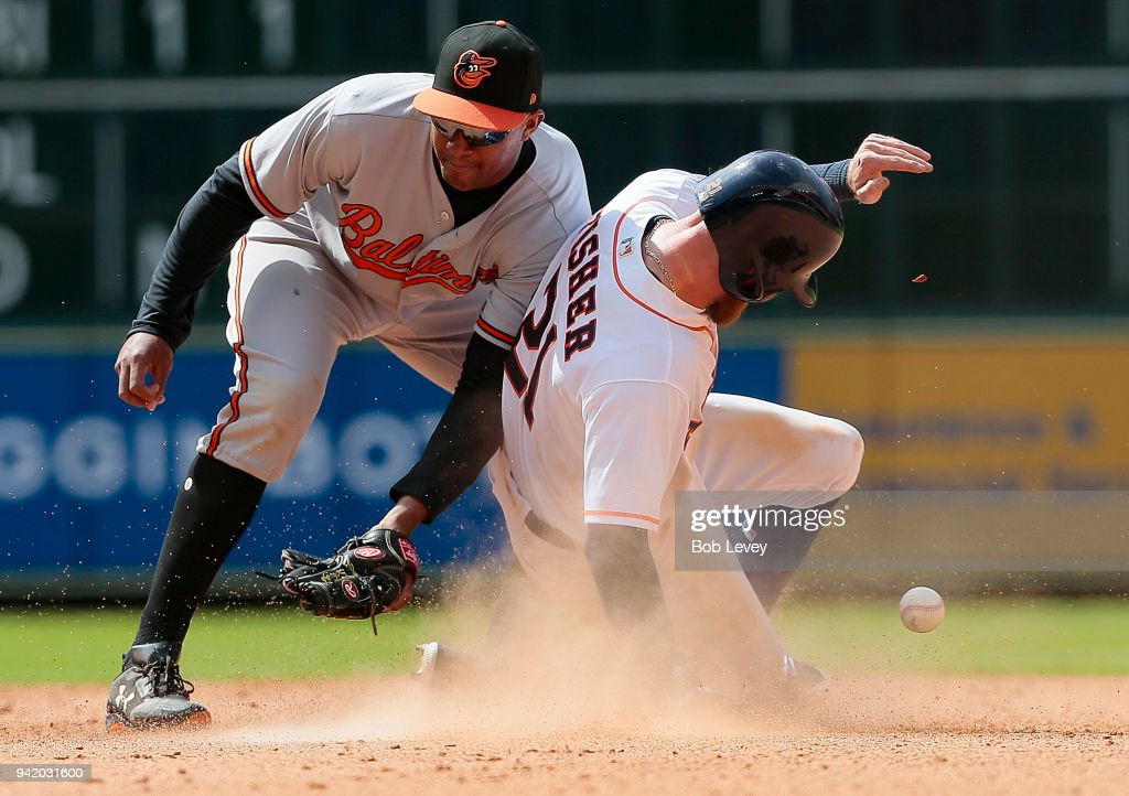 Derek Fisher #21 of the Houston Astros steals second base as Jonathan Schoop #6 of the Baltimore Orioles is unable to field the ball in the seventh inning at Minute Maid Park on April 4, 2018 in Houston, Texas.