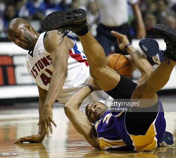 Derek Fisher of the Los Angeles Lakers and Elden Campbell of the Detroit Pistons fight for the lose ball during the second half of game four of the...
