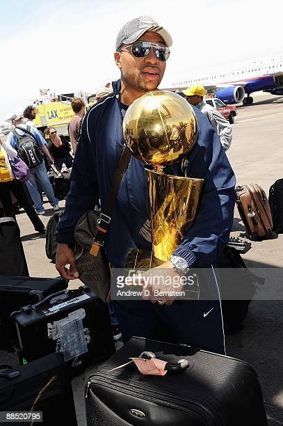 Derek Fisher of the Los Angeles Lakers arrives at LAX with the Larry O'Brien trophy on June 15 2009 in Los Angeles California after the Lakers...
