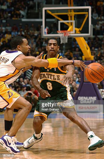 Derek Fisher of the Los Angeles Lakers blocks a pass by Kevin Ollie of the Seattle Sonics during the game at Staples Center on February 23 2003 in...
