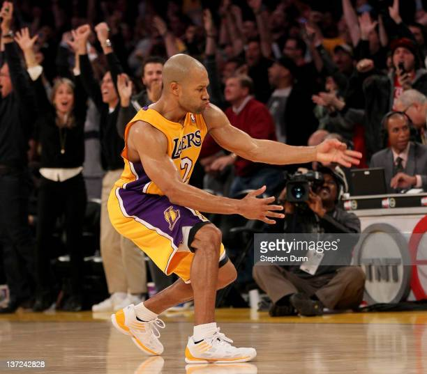 Derek Fisher of the Los Angeles Lakers celebrates after making the winning three point basket with 31 seconds left in the game against the Dallas...