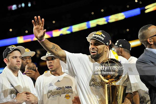 Derek Fisher of the Los Angeles Lakers celebrates with the Larry O'Brien Championship Trophy after defeating the Boston Celtics 8379 in Game Seven of...