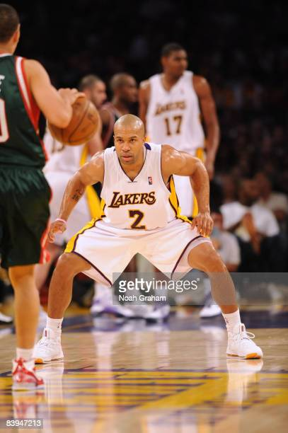 Derek Fisher of the Los Angeles Lakers defends during the game against the Milwaukee Bucks at Staples Center on December 7 2008 in Los Angeles...