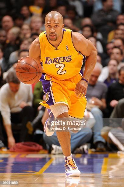 Derek Fisher of the Los Angeles Lakers drives the ball upcourt against the Charlotte Bobcats during the game on February 3 2010 at Staples Center in...