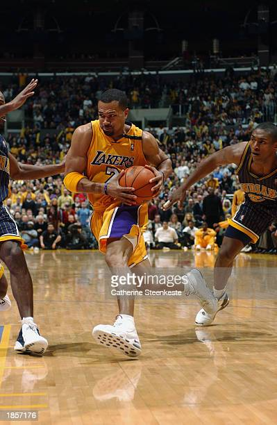Derek Fisher of the Los Angeles Lakers drives to the basket against the Indiana Pacers during the game at Staples Center on March 5 2003 in Los...