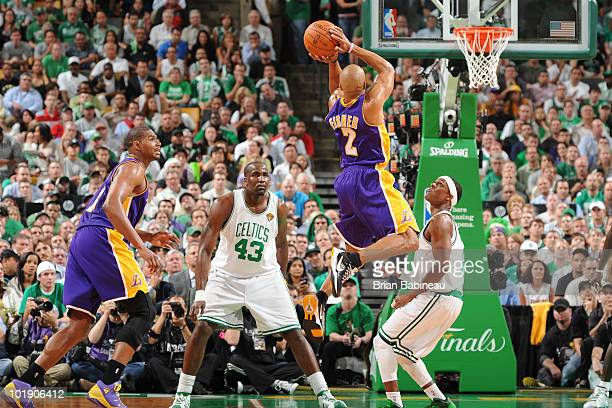Derek Fisher of the Los Angeles Lakers goes up for a shot against Rajon Rondo of the Boston Celtics in Game Three of the 2010 NBA Finals on June 8...