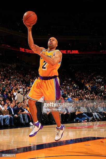 Derek Fisher of the Los Angeles Lakers goes up for the layup against the Golden State Warriors at Oracle Arena March 24, 2008 in Oakland, California....