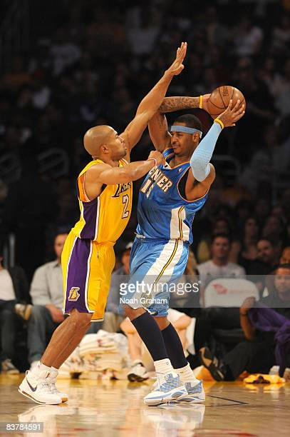 Derek Fisher of the Los Angeles Lakers guards Carmelo Anthony of the Denver Nuggets at Staples Center on November 21 2008 in Los Angeles California...