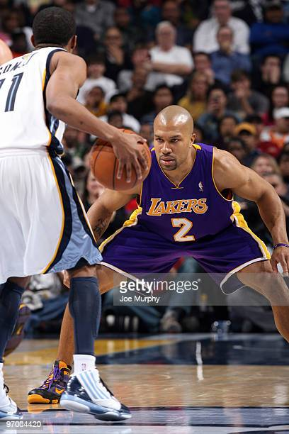 Derek Fisher of the Los Angeles Lakers guards Mike Conley of the Memphis Grizzlies on February 23 2010 at FedExForum in Memphis Tennessee NOTE TO...