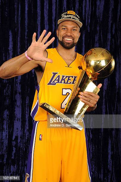 Derek Fisher of the Los Angeles Lakers holds up five fingers for a portrait following his team's victory over the Boston Celticsin Game Seven of the...