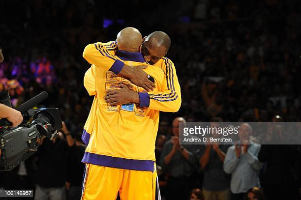 Derek Fisher of the Los Angeles Lakers hugs teammate Kobe Bryant during the 200910 NBA Championship ring ceremony before their game against the...