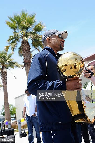 Derek Fisher of the Los Angeles Lakers is interviewed holding the Larry O'Brien trophy at LAX on June 15 2009 in Los Angeles California after the...