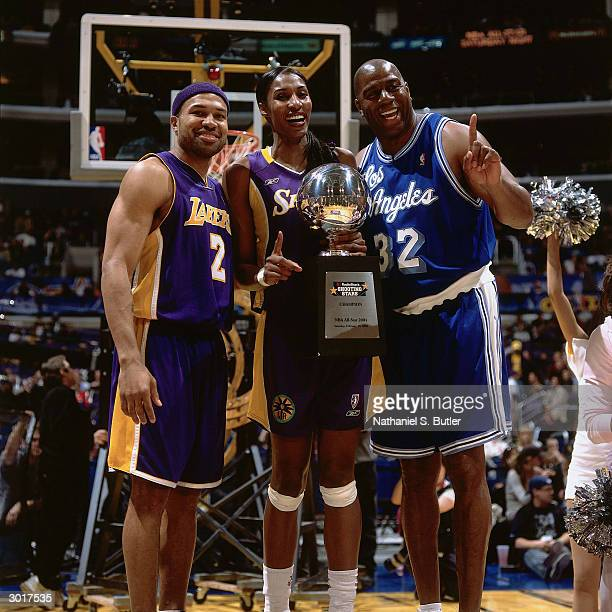 Derek Fisher of the Los Angeles Lakers Lisa Leslie of the Los Angeles Sparks and Magic Johnson are winners of the RadioShack Shooting Stars...