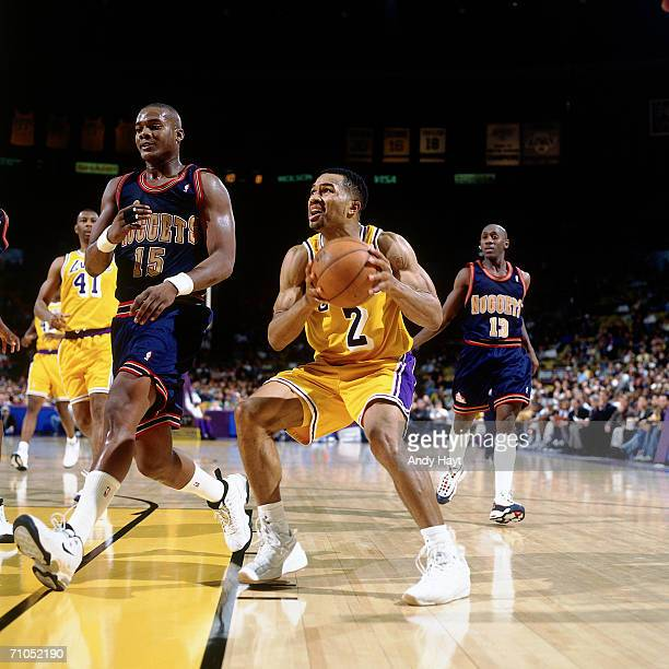 Derek Fisher of the Los Angeles Lakers looks for the basket against the Denver Nuggets during the game at the Great Western Forum on January 14 1998...