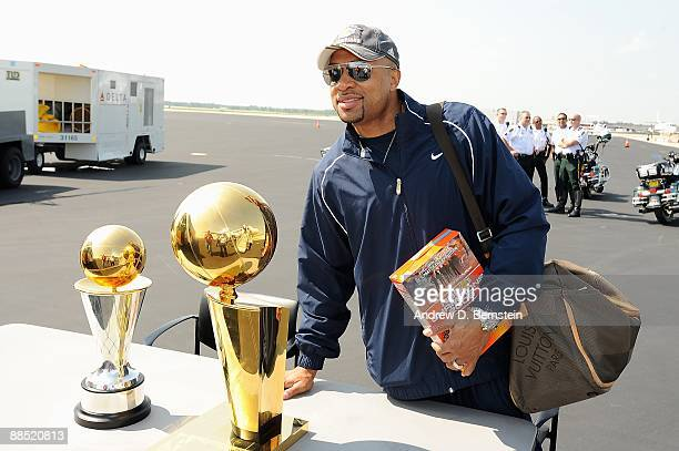 Derek Fisher of the Los Angeles Lakers poses with the Larry O'Brien trophy and the Bill Russell MVP trophy on June 15 2009 in Los Angeles California...