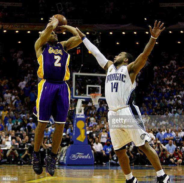 Derek Fisher of the Los Angeles Lakers shoots a gametying threepoint shot over Jameer Nelson of the Orlando Magic in the fourth quarter of Game Four...