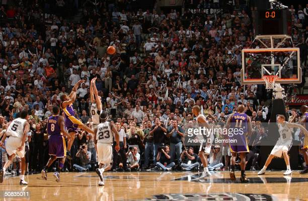 Derek Fisher of the Los Angeles Lakers shoots and makes the gamewinning shot over Emanuel Ginobili of the San Antonio Spurs at the buzzer in Game...