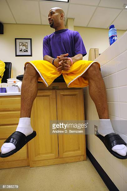 Derek Fisher of the Los Angeles Lakers sits in the training room before taking on the San Antonio Spurs in Game Five of the Western Conference Finals...
