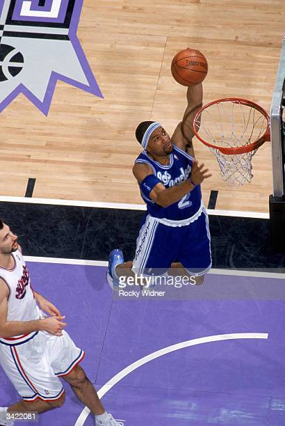 Derek Fisher of the Los Angeles Lakers takes the ball to the basket during the game against the Sacramento Kings at Arco Arena on April 11 2004 in...