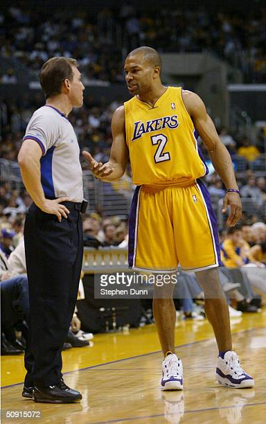 Derek Fisher of the Los Angeles Lakers talks with referee Ron Garretson in Game three of the Western Conference finals during the 2004 NBA Playoffs...
