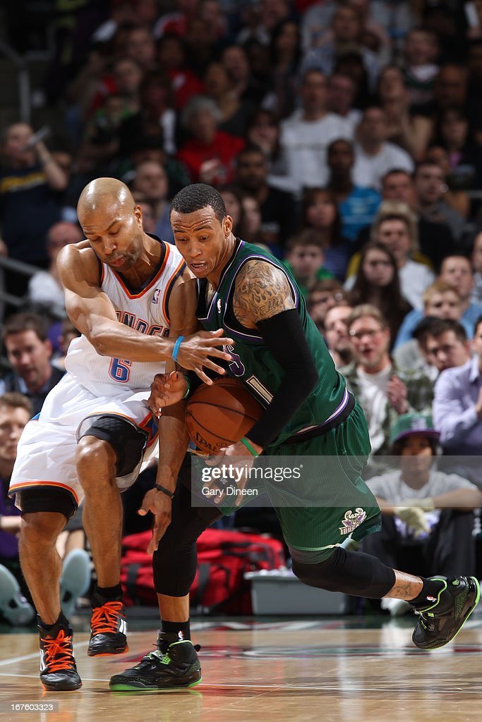 Derek Fisher #6 of the Oklahoma City Thunder battles for a loose ball against Monta Ellis #11 of the Milwaukee Bucks on March 30, 2013 at the BMO Harris Bradley Center in Milwaukee, Wisconsin.
