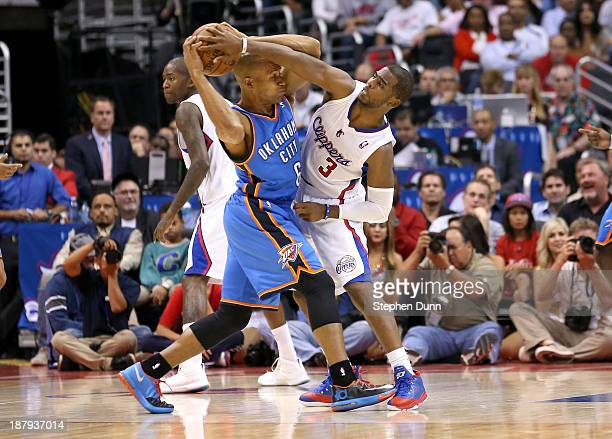 Derek Fisher of the Oklahoma City Thunder battles with the ball against Chris Paul of the Los Angeles Clippers at Staples Center on November 13 2013...